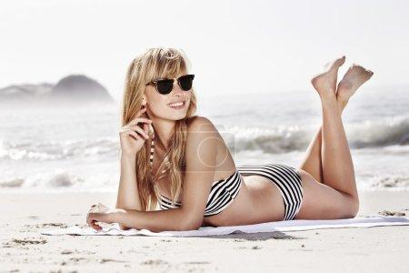 Sun and shades for bikini girl