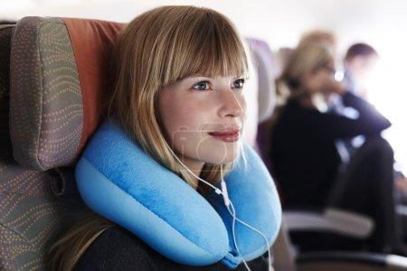Woman passenger on airplane