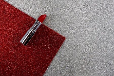 Red lipstick on gray