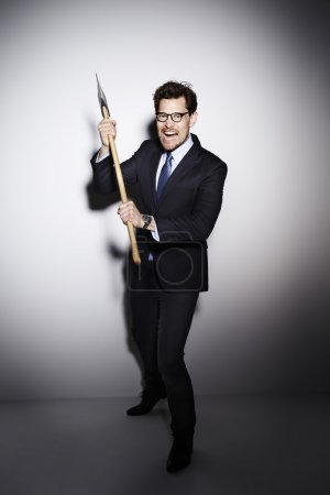 Photo for Suited psychopathic businessman with axe, portrait - Royalty Free Image