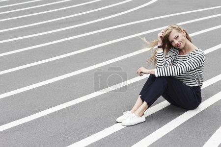 fashion model sitting on the road