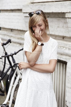 Giggling woman in white dress