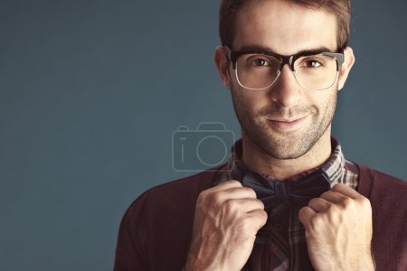 male with bow tie smiling