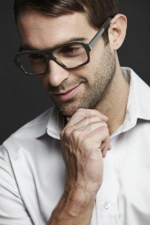Man in glasses looking down