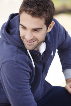 Man in hooded top smiling