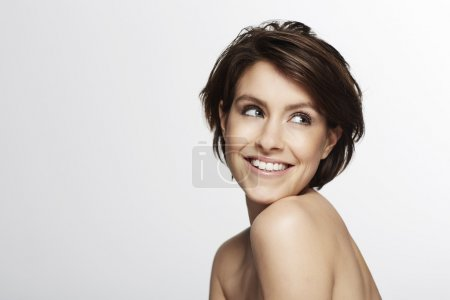 Photo for Portrait of beautiful woman smiling  in studio - Royalty Free Image