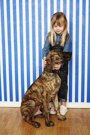 Girl holding large dog