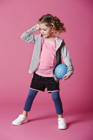Photo for Young girl in sportswear holding soccer ball - Royalty Free Image