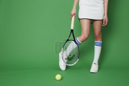 Tennis player against green