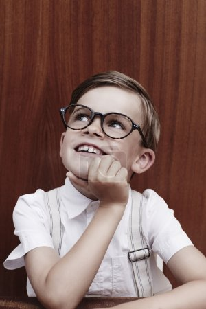 Boy in glasses looking up