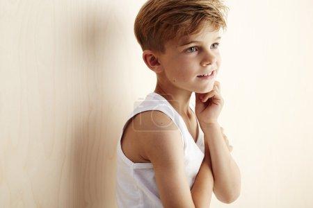 Boy in vest looking away