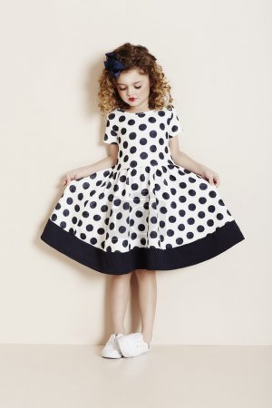 Girl looking at spotty dress