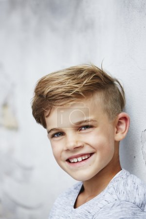 Boy leaning against wall