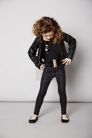 Cool girl in leather jacket looking down
