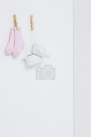 Socks and booties against white