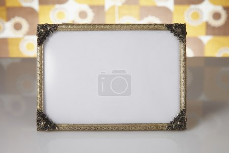 Photo for Blank picture frame against kitsch background - Royalty Free Image