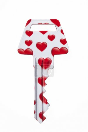 Photo for Key covered with red hearts against white background - Royalty Free Image