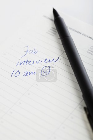 Pen and diary entry for interview