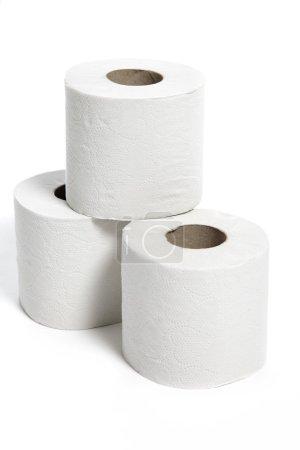 Toilet rolls against white