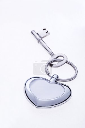 Key on heart shaped ring