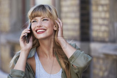 woman smiling at phone call