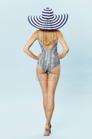 Photo for Beautiful blond woman posing in swimsuit, rear view - Royalty Free Image