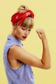 Young woman flexing bicep