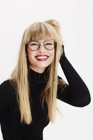 Photo for Portrait of studious young woman smiling - Royalty Free Image