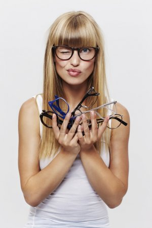 Student holding heap of glasses