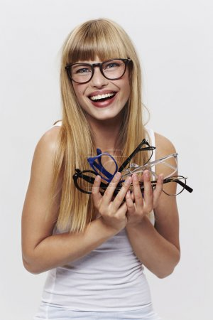 Photo for Student laughing with glasses in studio - Royalty Free Image