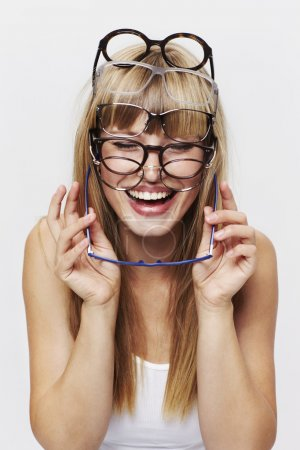 Photo for Student holding heap of glasses - Royalty Free Image