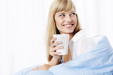 Offee in bed for young model