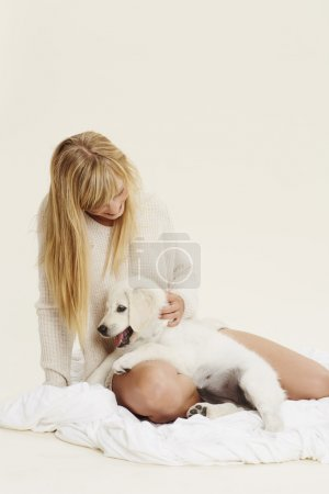 blond woman with puppy