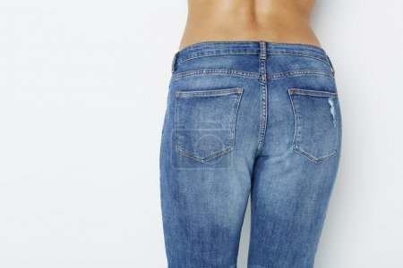Close up of woman in jeans