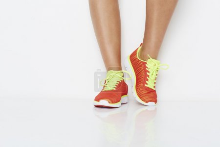 Low section of woman in sneakers