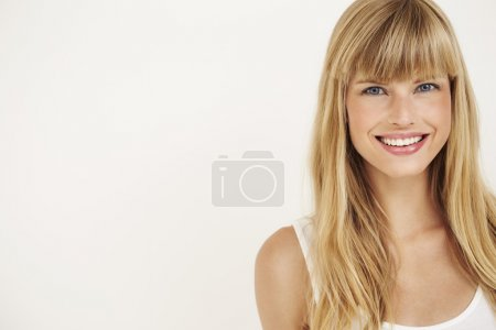 Photo for Young woman smiling at camera, portrait - Royalty Free Image