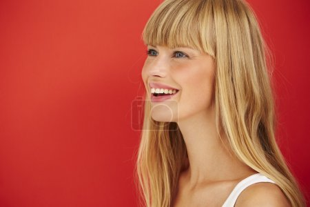 Smiling woman against red