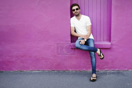 Photo for Portrait of young man against purple wall - Royalty Free Image