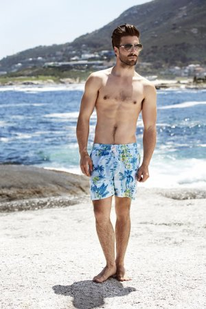 Young man in swimming shorts