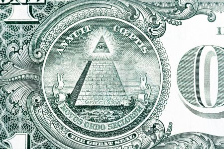 Part of one dollar note with great seal.