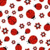 Ladybugs with red flowers on white seamless pattern