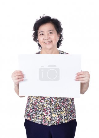 Asian senior female standing with empty horizontal blank paper i