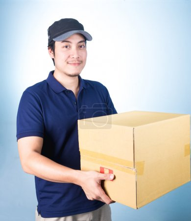 Smiling handsome asian delivery man giving and carrying parcel o