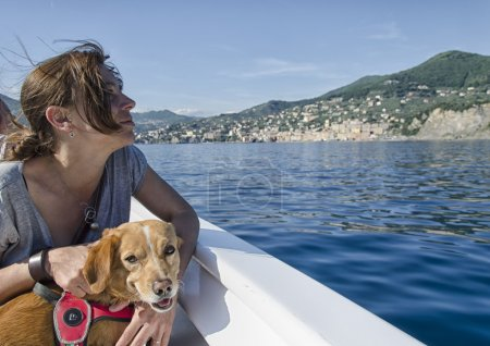 Woman and her dog on board