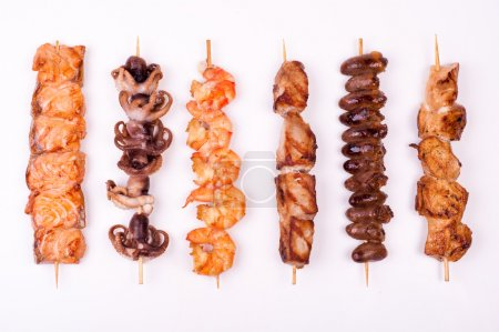 Set of different meat skewers