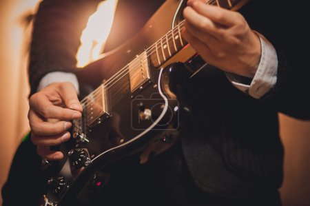 Photo for Men playing music on guitar no face - Royalty Free Image