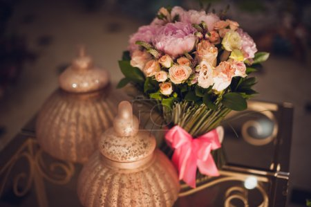 Bouquet of pink peonies  on table