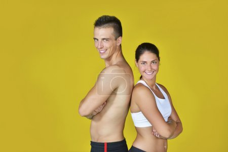 Young fit man and woman