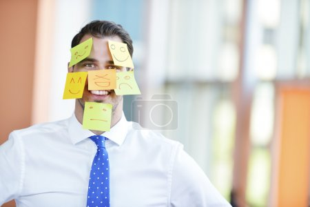 Business man with   stickers on face