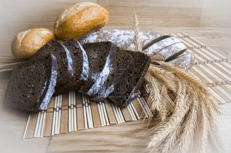 wheat bread on wooden background